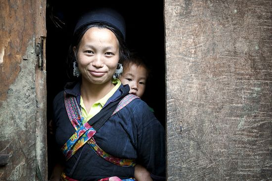 A Hmong woman and her baby in the village of Sin Chai, Viet Nam. According to UNICEF, the number of children who die before age five has fallen worldwide by more than half since 1960. Photo ID 491903. 23/06/2011. Sapa, Viet Nam. UN Photo/Kibae Park. www.unmultimedia....
