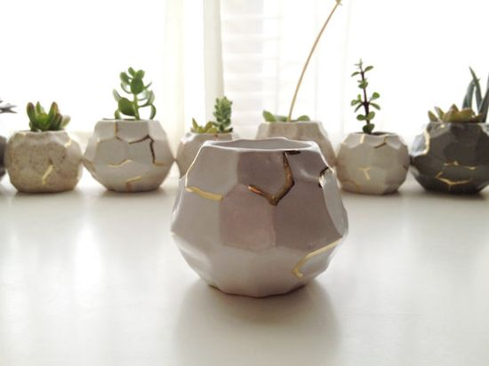 { faceted white and gold vases }