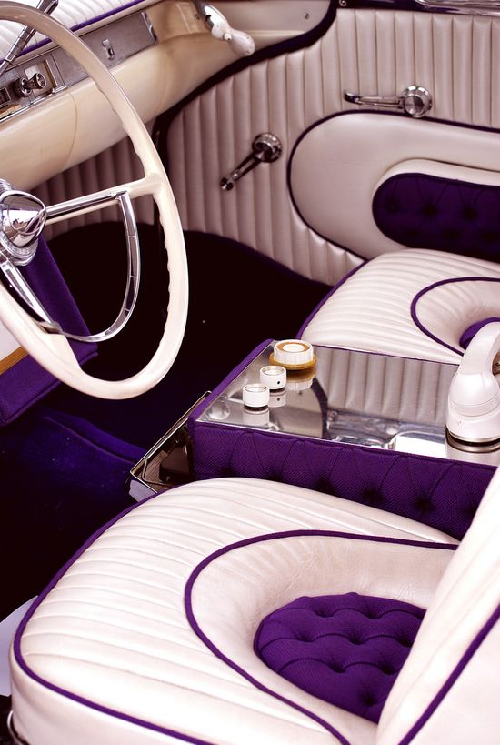 A hot car is always a must have accessory - I ? the purple and beige seats!