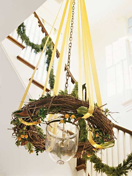 Decorate a lantern or chandelier with ribbon and a grapevine wreath.