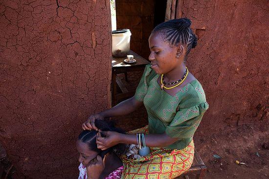 Somali Bantu woman braiding hair, Tanzania