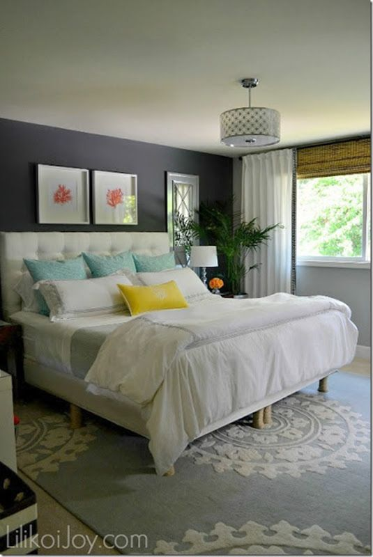 gray master bedroom with white, coral, blue, and yellow