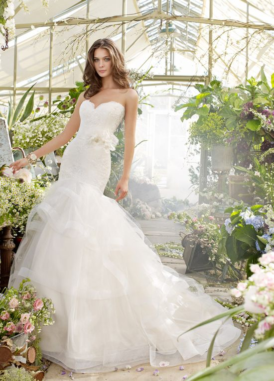 Dreamy, feminine, stunning wedding dress.  Tara Keely: Ivory Alencon lace bridal gown with strapless sweetheart neckline and elongated bodice, three tiered tulle skirt with trim and chapel train.