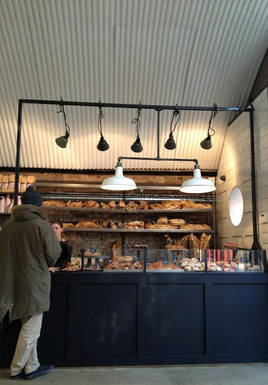 fabrique bakery, london. i like the pendants, the shelf wall, and the lil glass-wall display.