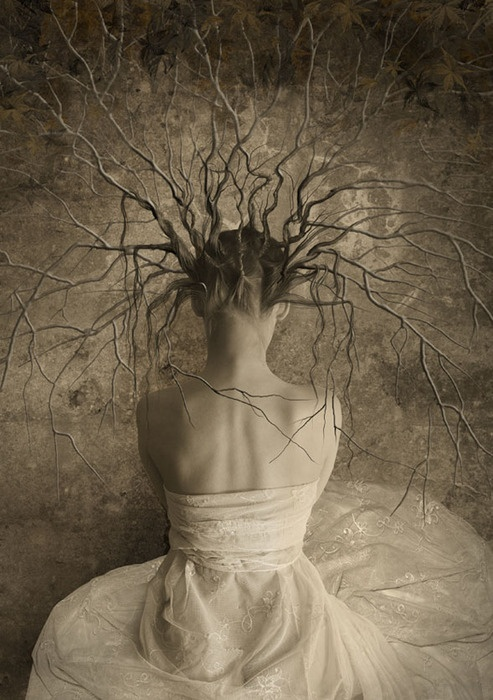 sepia woman with tree hair