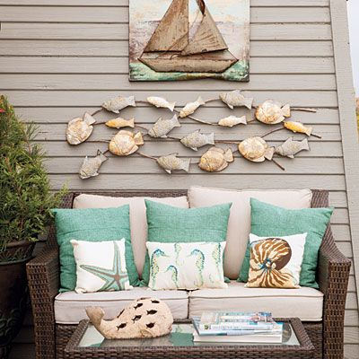 Set Up a Romantic Spot Outdoors -                                       Sometimes it's not enough to just enjoy breathtaking water views from inside the house. Carve out a cozy outdoor niche with references to sea life, all-weather seating, and lots of overstuffed pillows.