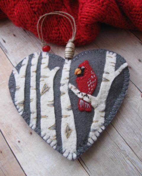 Felt cardinal ornament - i like the background color, heart shape, trees, and hanger with bead, as well as stitching around border and on cardinal. I think I'd like to see the cardinal smaller, from the side, face is a little ... ? Overall I like this though. Birch Bark Beads: Cardinal #handmade barbie house #homemade cards #handmade soap