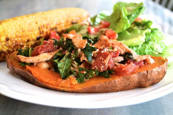 Chipotle Chicken Stuffed Sweet Potatoes with kale, spinach, and tomatoes. Healthy weeknight dinners with a twist!