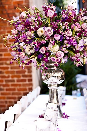 Purple wedding with gorgeous floral arrangements. Photography by suzygphotography.com
