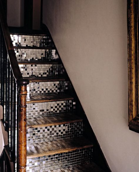 Mirrored mosaic tile staircase - wow.