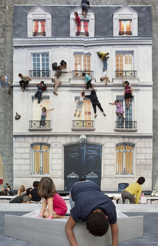 Leandro Erlich's installation called Bâtiment now on display at Le 104 in Paris looks like so much fun. A gigantic mirror reflects a house which gives visitors the illusion that they can hang off ledges and if kids (or adults) want, they can even get their Spiderman crawl on.