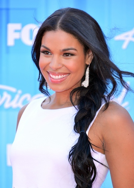 Beat the heat with this laid-back braid like Jordin Sparks! 1) Texturize hair with product 2) Part, tuck and pull hair to one side. Create a side part and tuck hair behind ears, leaving out any shorter layers you may have in the front. Pull hair to the opposite side of the part, by your shoulder. 3) Braid hair starting below the ear 4) Pin any too-loose strands and loosen with fingers 5) Style front pieces and finish with a light spray!