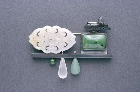 "Jack Cunningham - ""Japan"" series -  ""The Peak"" brooch 2003 white metal, obsidian, jade, nephrite, rock crystal"
