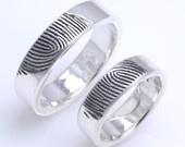 Fingerprint wedding bands.