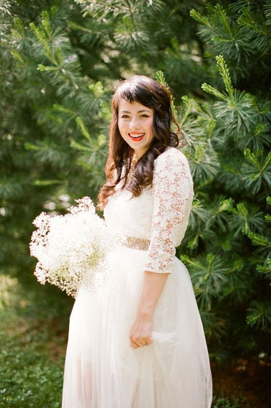 adorable bride in a white lace dress