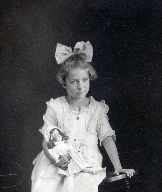 vintage photo Young girl with her doll Look what I got for Christmas