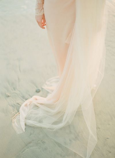 tulle on the beach for this engagement shoot Photography by ashleykelemen.com  Read more - www.stylemepretty...