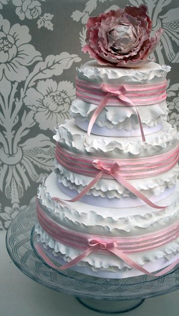 Pink and white frilly wedding cake