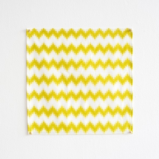 Bright yellow pixel chevron striped napkins from Pigeon Toe Ceramics via Decor8