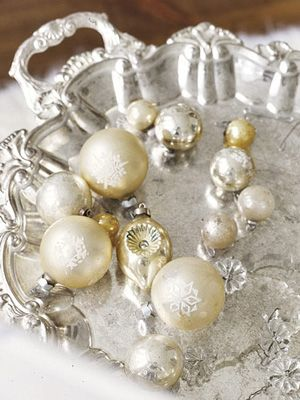 Vintage ornaments on a silver tray