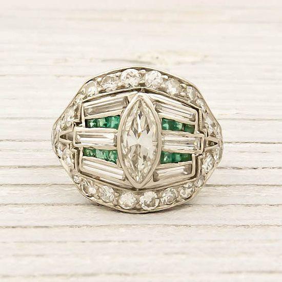 Antique platinum diamond and emerald art deco ring