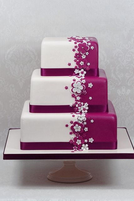 Could easily be done in Blue/green and white for a baby shower cake...smaller, though. Purple and White Wedding Cake