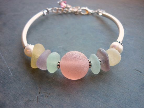 Sea glass bracelet from rare pink, deep purple and yellow beach glass, $82 from The Mystic Mermaid on etsy - so very lovely :)