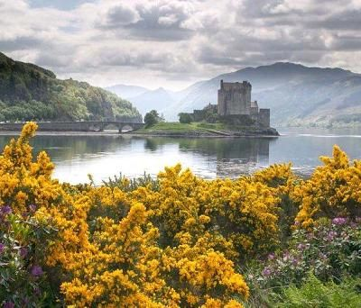 Scottish countryside  This is Eilean Donan Castle (MacRae Castle)