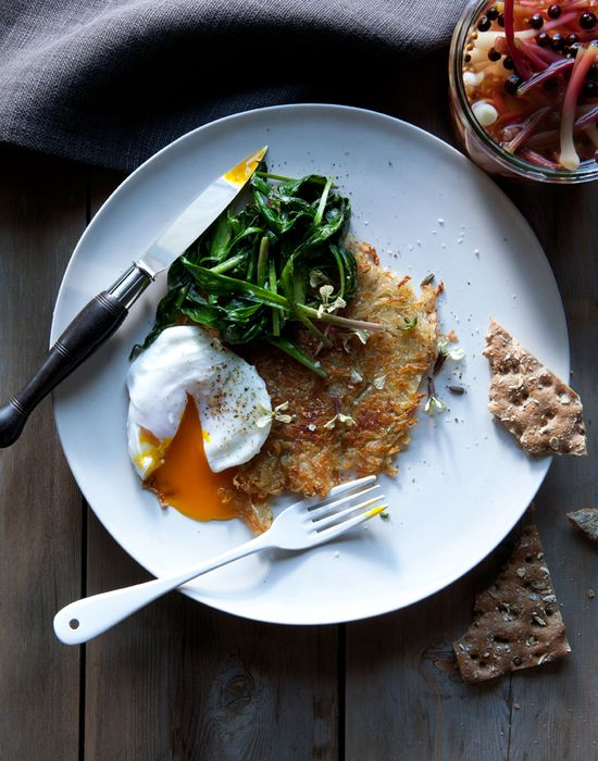 // poached eggs over rosti with sauteed ramp greens and pickled ramps