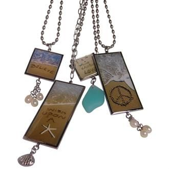 Keep the beach close to heart with beach jewelry that features messages handwritten in the sand.