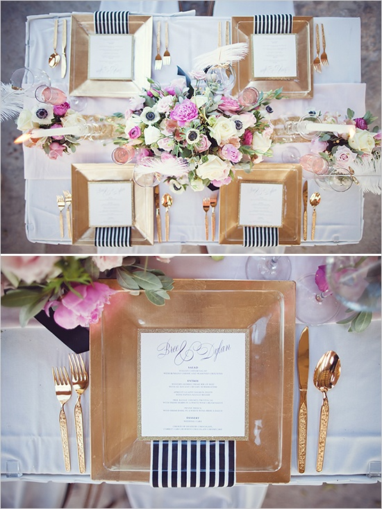gold table decor with black and white stripes