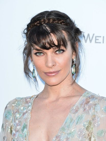 Braids: Milla Jovovich's crown braid is messy and boho.