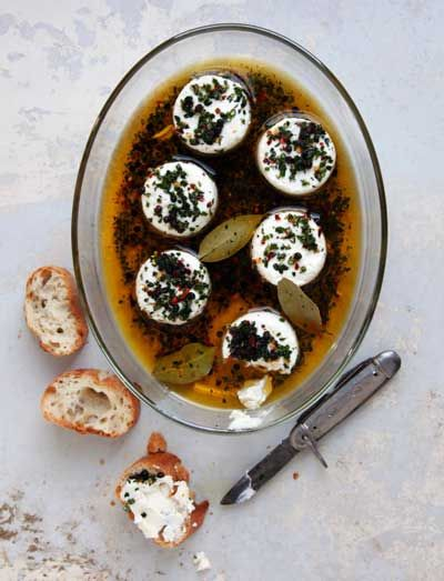 Yummy Marinated Goat Cheese served with toasted bread! (Saveur)