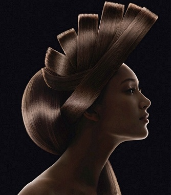 A long brown straight scultptured avant garde hairstyle by Gregory Kaoua