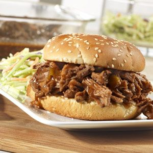 Sweet and Spicy Barbecued Brisket - Brown sugar makes it sweet, picante and Worcestershire sauces makes it spicy, and slow cooking makes it tender and delicious. Serve the brisket on sandwich buns or rolls to soak up all the flavorful sauce.