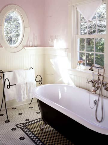 A nostalgic-but-new claw-foot tub nestles into the corner of this Victorian-inspired bath. Old-fashioned nickel fixtures accented with white porcelain handles would have been the height of style and function in the Victorian era and work just as well now to extend the vintage theme.