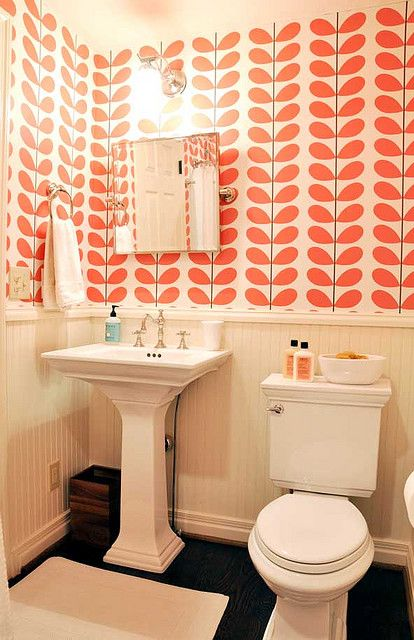 Bright wallpaper balanced by otherwise neutral color palette and clean lines