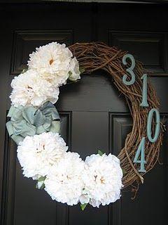 dark door and a wreath.