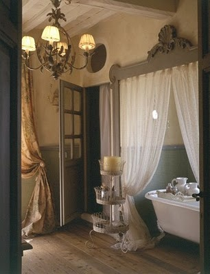 Curtain in front of tub for a romantic bathroom