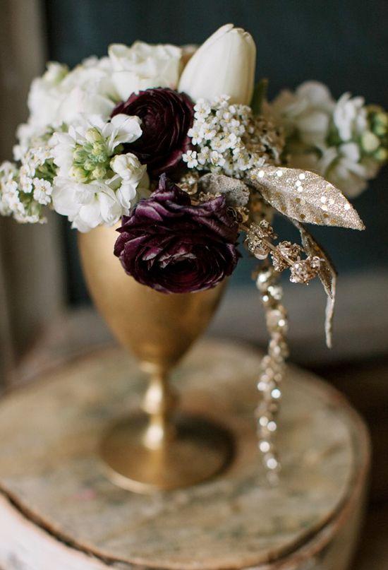 deep purple, white and gold flower arrangement