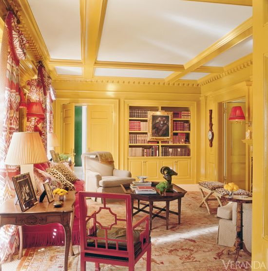 Yellow library with red accents - Houston home designed by Miles Redd