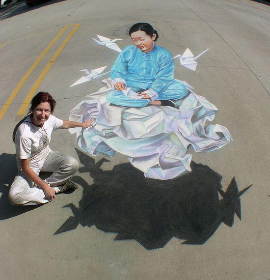 Traci Lee Stum and her street painting   #creative #street #floor #flooring #original #amazing #nice #like #love #follow #finsahome #wonderfull #beautiful #strange #cool #opticalillusion #hole #incredible #extraordinary #deep #art #drawing #illusion #fake #delusion #false #graphicart #work #road #artstreet #funny #3D #chalk