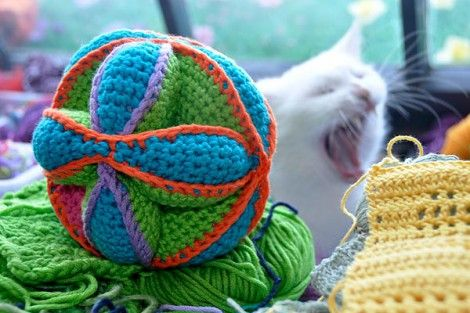 Crochet cat ball toy.