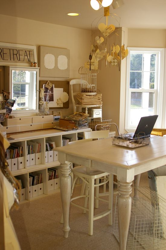 Home office art craft room, white to off white. Great storage and pretty table.