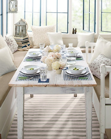 A great space to dine, created with our Trimaran Indoor-Outdoor Rug by Dash & Albert.