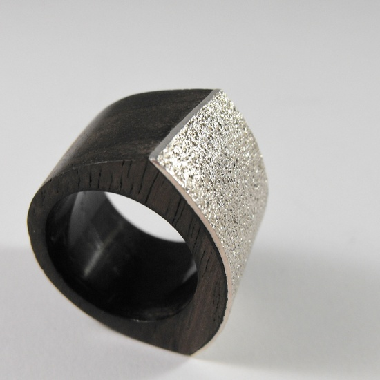 Grit. Handmade BlackWood and  Sterling Silver Size 7 Abstract Modern Design Mixed Media Ring. $42,00, via Etsy.