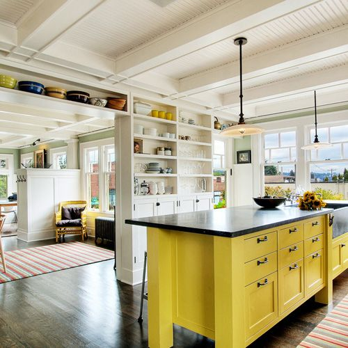Loving the yellow island in this casual chic home.