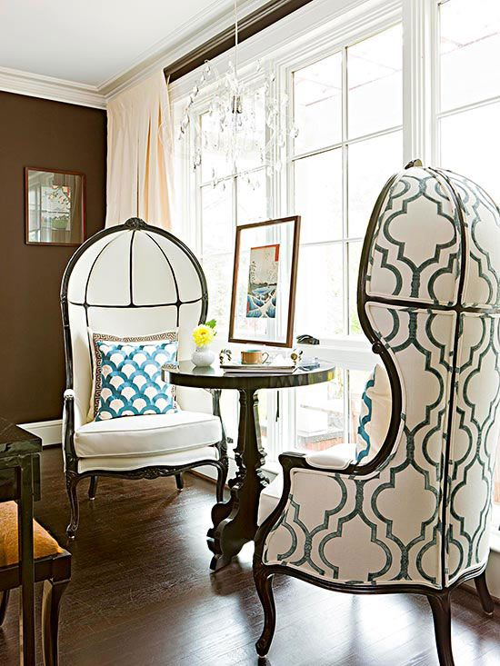 Funky chairs create a unique space by the window! More colorful spaces: www.bhg.com/...