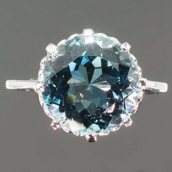 Intense blue aquamarine platinum engagement ring