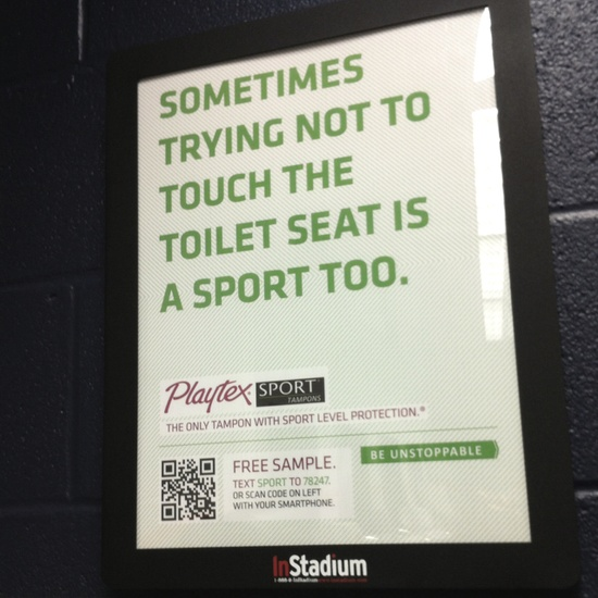Funny advertisement in Stadium bathroom.